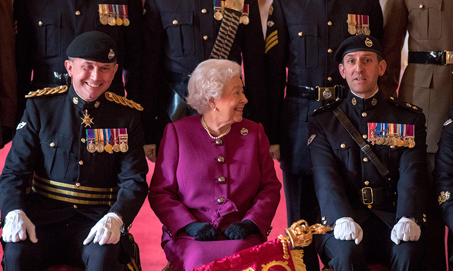 <p>Queen Elizabeth II smile over at Colonel-in-Chief of the Royal Tank Regiment. Her Majesty presented the regiment with their new standard in St George's Hall at Windsor Castle on April 25.</p>