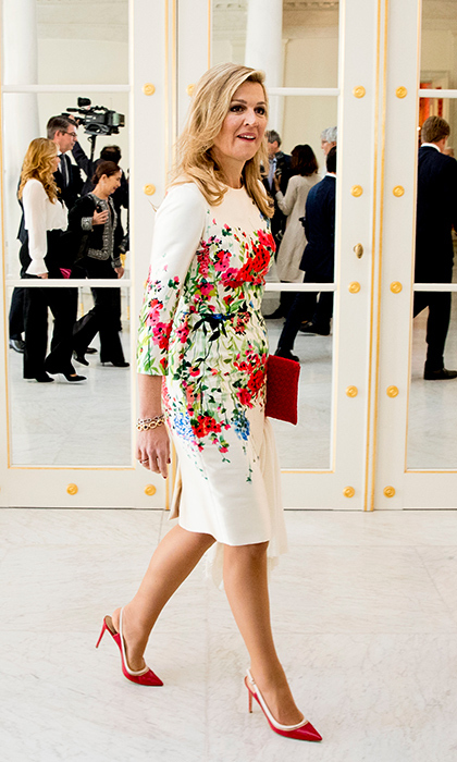 <p>Queen Maxima always looks amazing in florals! She paired this white dress with red-and-white slingback heels.</p>