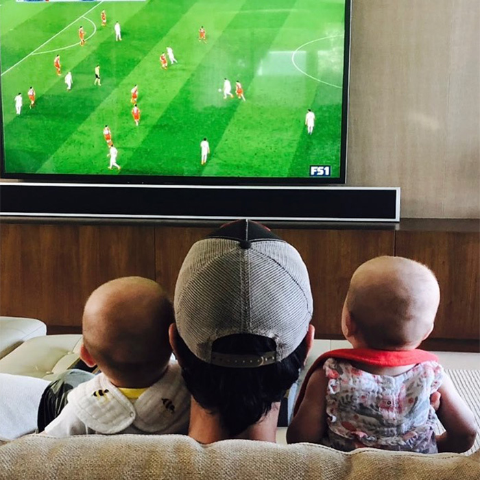 "<p>Starting them young! Enrique Iglesias shared an adorable snap with his new baby twins, captioning it, ""Game day!!""</p>