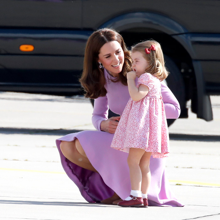 <p>Despite being a little tired, Princess Charlotte behaved so well while on their royal tour in Germany. Her loving mom made sure to cheer her up on the tarmac.</p>