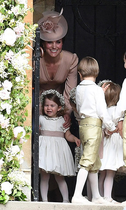 <p>The Duchess had a tough (but adorable!) job at her sister's, Pippa Middleton, wedding – keeping the kids in line!</p>