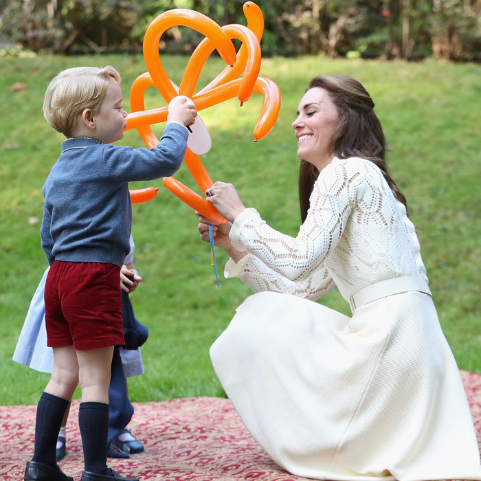 <p>Kate isn't afraid to share some playtime with her kids.</p>
