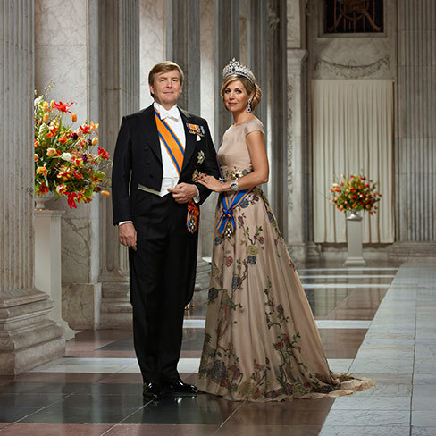 Another shot shows the monarch, 50, and his 46-year-old wife, Queen Máxima, in formal regalia posing in a gorgeous marble corridor. Willem-Alexander wore the Knight Grand Cross Military Order of William, the blonde beauty looked regal as ever in the Grand Cross in the Order of the Dutch Lion and a breathtaking tiara. 