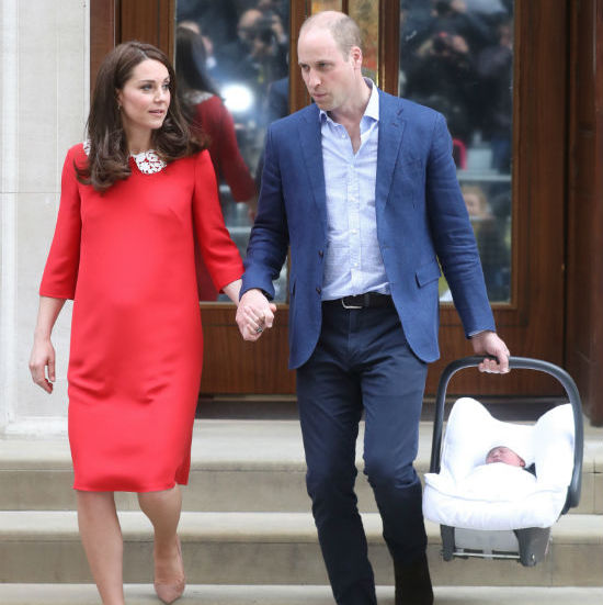 In a rare show of public affection, the couple held hands as they walked down the stairs outside the Lindo Wing, ready to head home and start their new life as a family of five! Little Prince Louis was snug and cozy in his Britax carrier. 