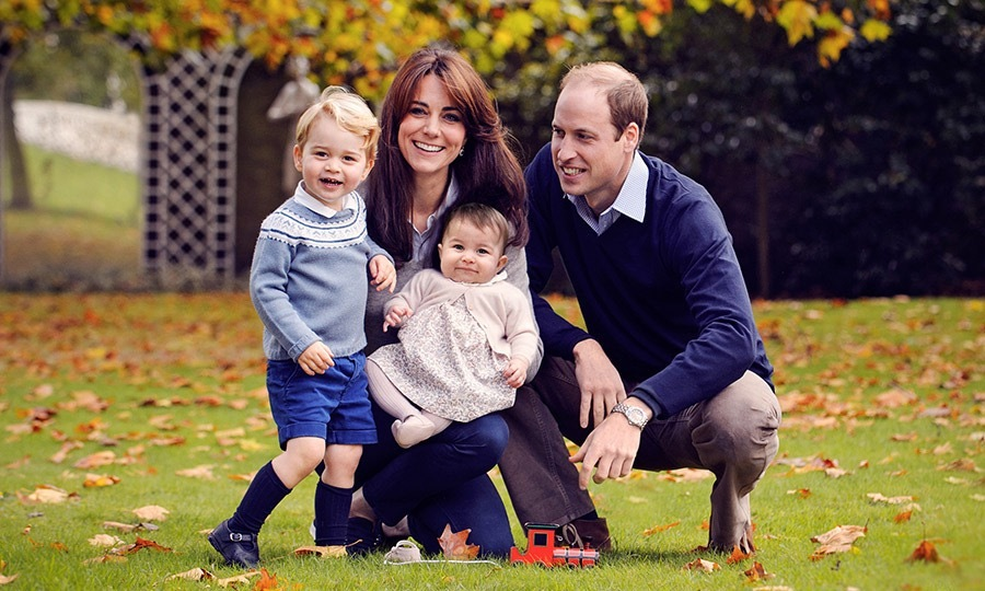 Prince George was having a ball as the family posed for their 2015 Christmas portrait. Prince William's affection for his kids was on clear display as he gazed on lovingly at his little ones while doting mom Kate smiled at the camera.