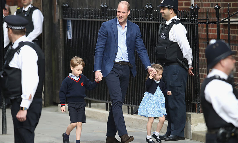 Prince William ran home to get George and Charlotte so they could meet their baby brother at the Lindo Wing. After unbuckling his kids one at a time, he held their hands reassuringly as they made their way inside the hospital.