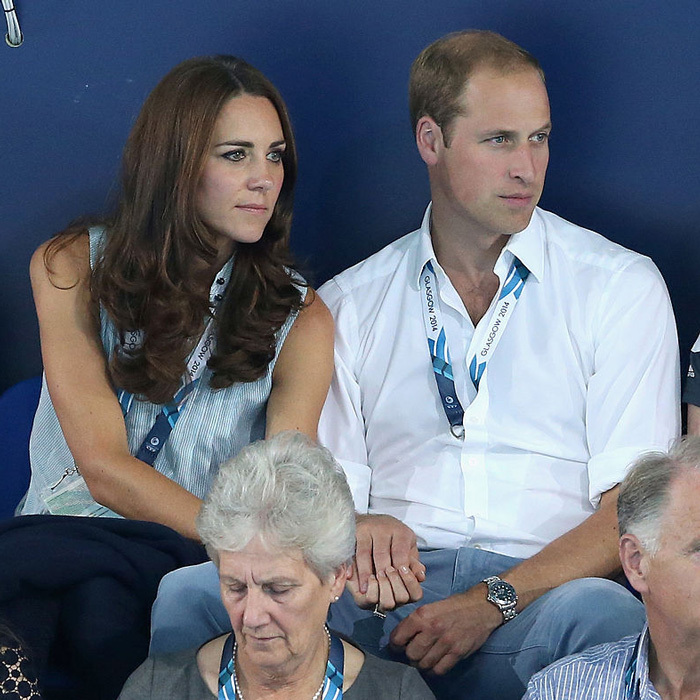 The British royals sweetly clasped hands as they attentively watched a swimming competition at the Tollcross Swimming Centre during the 2014 Commonwealth games in Glasgow, Scotland. 