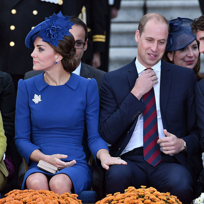 Duchess Kate and Prince William's togetherness was discreetly on display as she placed her hand on her husband's knee at an official welcoming ceremony on day one of their 2016 royal tour of Canada.