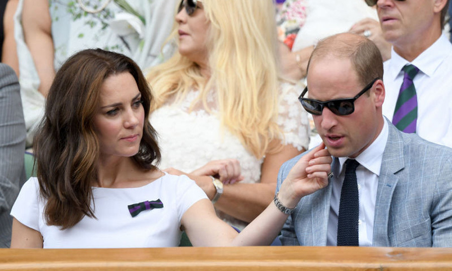 During the men's final at Wimbledon, Duchess Kate gently stroked her husband's cheek as they watched Roger Federer's match from the royal box.