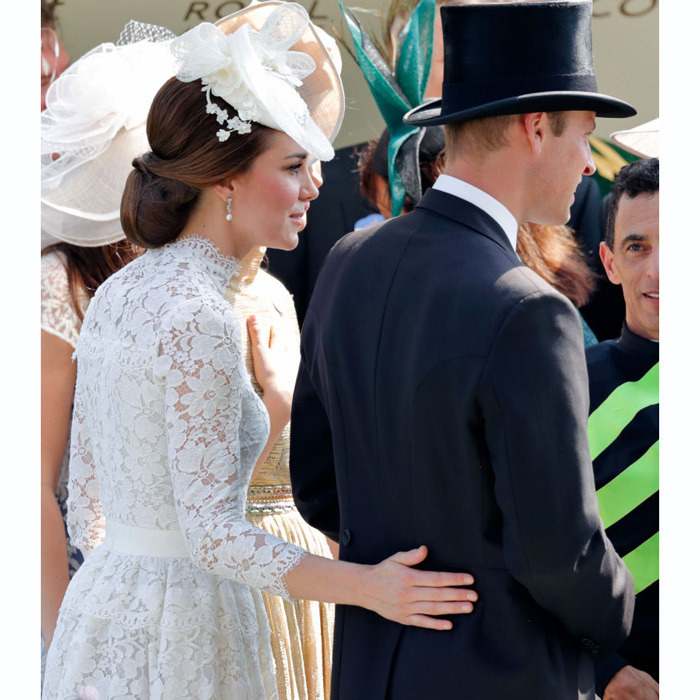 Kate placed her hand on Prince William's lower back as they made their way through the crowd at the 2017 Royal Ascot.