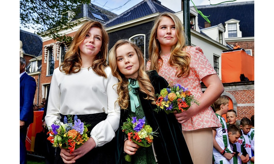 Picture perfect! Dutch princesses Alexia, 12, Ariane, 11, and Catharina-Amalia, 14, looked all grown up as they posed at their dad's birthday celebration. 