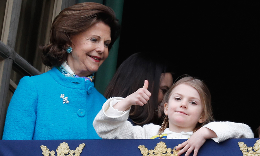 <p>Thumbs up from Princess Estelle! Queen Silvia looked happy as a clam, too, all dressed in blue.</p>