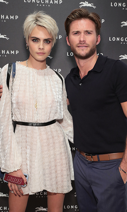 <p>Cara Delevingne and Scott Eastwood made dapper appearances for the opening of Longchamp Fifth Avenue Flagship on May 3.