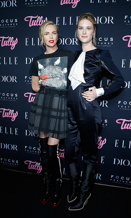 <p>How much cooler can you get? Charlize Theron and Mackenzie Davis stopped for a stylish photo at a screening of <em>Tully</em> on May 3.