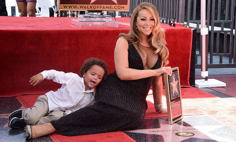 <p>It is definitely not easy to upstage Mariah Carey! But the singer's son Moroccan did just that as his famous mom lounged on her Hollywood star in August 2015.</p>