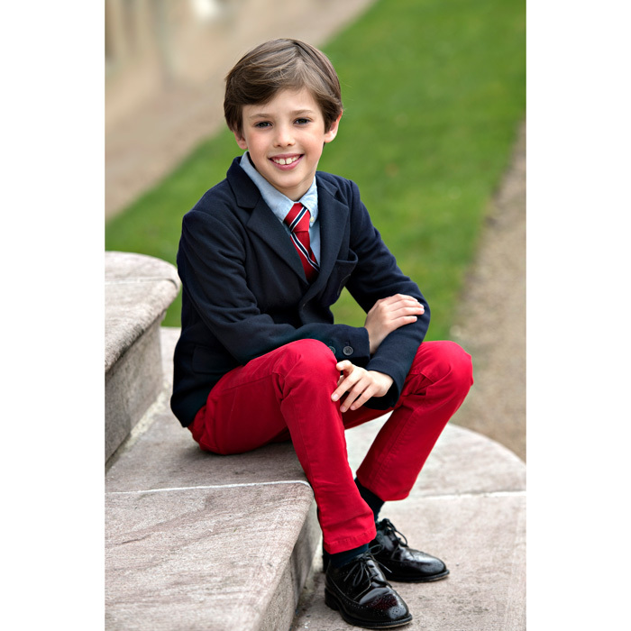 Denmark's newest model! Prince Henrik looked picture perfect in two new photos released for his ninth birthday, which the young royal celebrated on May 4. Prince Joachim and Princess Marie's son looked dapper in a navy blazer, red trousers, a red-and-blue tie and black leather shoes. 