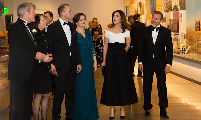 While in Washington, Denmark's Crown Princess Mary made a glamorous appearance at the Nordic Museum, where she wore a black and white evening dress that featured a stunning criss-crossed off-the-shoulder bodice. The mother of four joined executive director Eric Nelson, US Senator Maria Cantwell, President of Iceland Gudni Th. Johannesson, Iceland First Lady Eliza Reid and Denmark Foreign Minister Anders Samuelsen on a tour of the space on May 4.