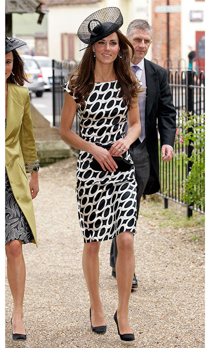 Barely two months after donning Alexander McQueen for her Westminster Abbey wedding, Kate opted for a graphic-print dress from Zara and a Lock & Company hat at Sam Waley-Cohen and Annabel Ballin's June 2011 wedding. The ceremony was held at St Michael and All Angels church in Lambourn, England. 
