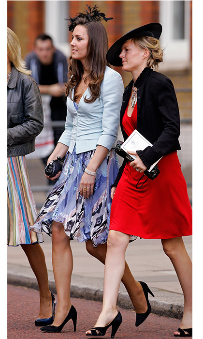 In the past, a day dress paired with a tailored jacket was Duchess Kate's go-to look for weddings. While a royal girlfriend, Kate opted for a silky violet frock and baby blue jacket to watch Lady Rose Windsor and George Gilman walk down the aisle at The Queen's Chapel, St James's Palace in July 2008.