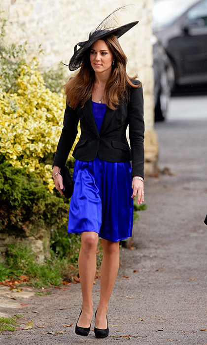 In October 2010, when Kate and Prince William attended Harry Meade and Rosie Bradford's nuptials at the Church of St. Peter and St. Paul in Cheltenham, the couple were keeping a secret – they were engaged! The future Duchess' blue Issa dress, worn with a black jacket and feathered hat, was in a similar shade, and by the same designer, as the now-iconic dress she would wear weeks later for the royal engagement announcement.