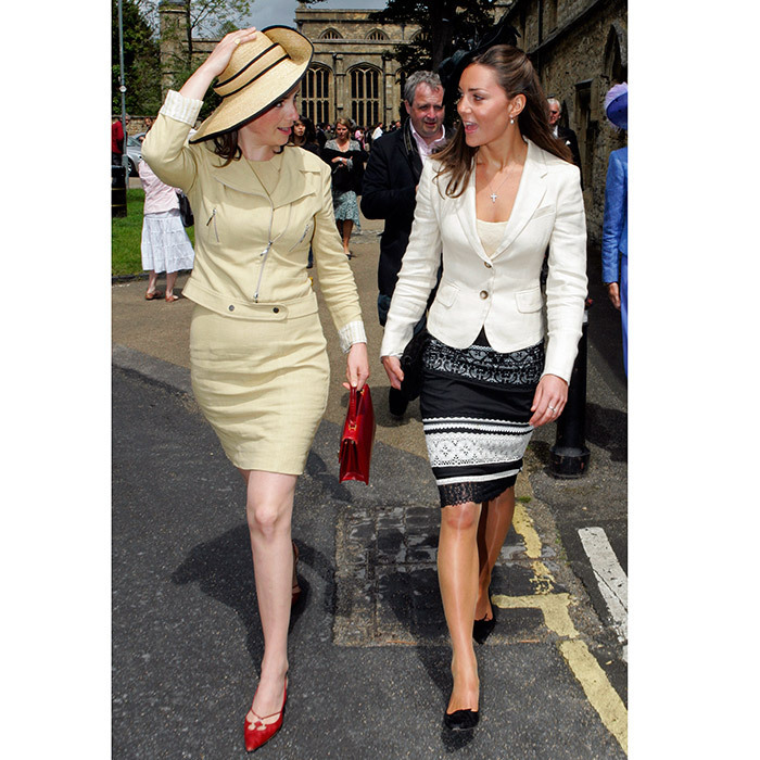 In this major throwback photo from June 2005, Kate wears a lace pencil skirt by Karen Millen with a cream blazer as she chats with a fellow guest at the wedding of Hugh Van Cutsem and Rose Astor at Burford Parish Church. 