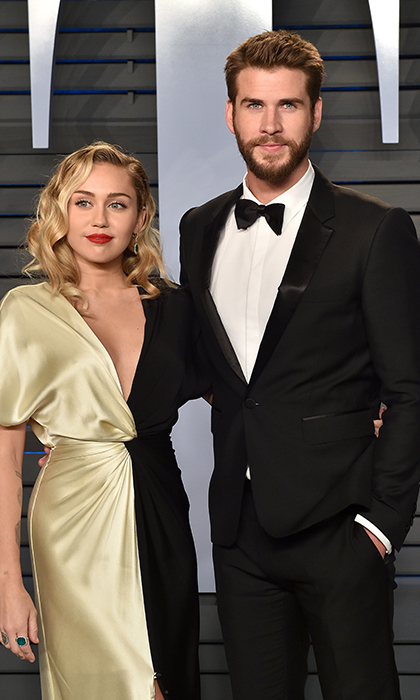<em>Miley Cyrus and Liam Hemsworth</em>