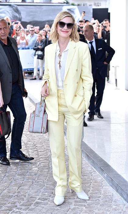 <p>Keeping in line with how she arrived in France, Cate Blanchett rocked another boyfriend-style suit – this time, in pale yellow!</p>