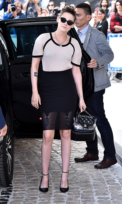 <p>Jury member Kristen Stewart posed for photos in this amazing black-and-cream outfit, paired, of course, with a chic Chanel backpack.</p>