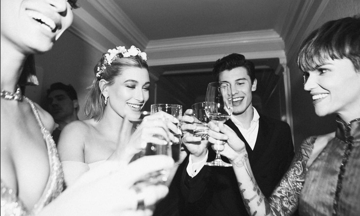 Hailey Baldwin and Shawn Mendes, who made their debut as a couple on the red carpet, toasted the fete with model pals Joan Smalls and Ruby Rose in a photo shared to the Canadian singer's Instagram.