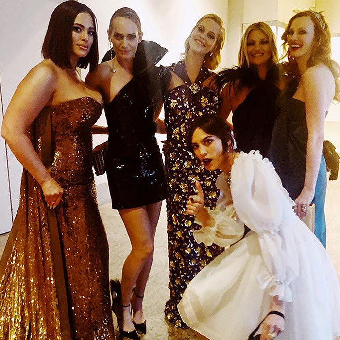 "Karen Elson, far right, was ""Met Balling with the Super Duper Models"", left to right, Ashley Graham, Amber Valletta, Poppy Delevigne, Kate Moss and, in the foreground, Alexa Chung.