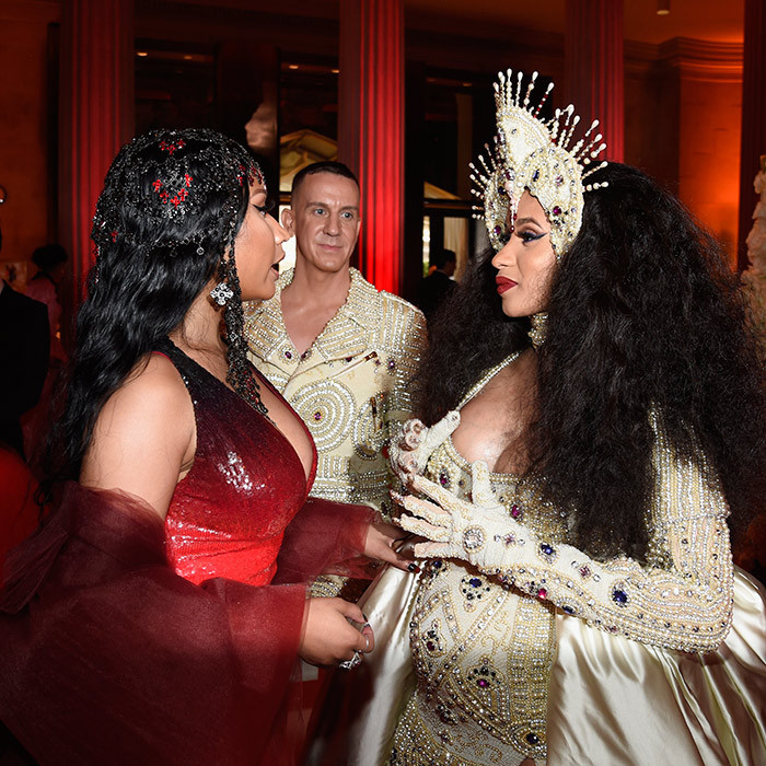 Designer Jeremy Scott looked on as Nicki Minaj, left, and pregnant Cardi B were deep in conversation at the Metropolitan Museum of Art fundraising gala. 