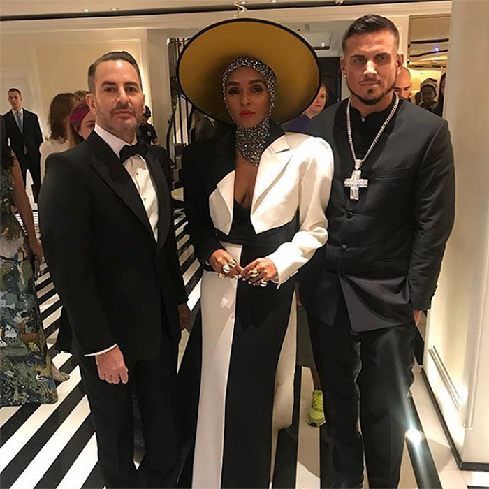 "Designer Marc Jacobs posted this photo of himself with Janelle Monae and Char Defrancesco to Instagram with the caption: ""So happy, proud and grateful to be able to escort the exquisite @janellemonae to the #Metgala2018 #heavenlybodies custom @marcjacobs @stephenjonesmillinery @chardefrancesco in @huntsmansavilerow @ifandco me in @huntsmansavilerow"".