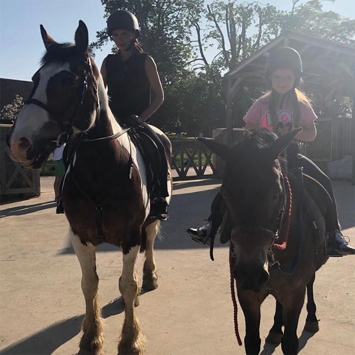 "<p>Victoria and Harper Beckham enjoyed a mother-daughter date on horseback while vacationing in Spain! The designer shared this sweet snap on Instagram, writing: ""Perfect end to the most perfect weekend x Riding with my baby in the sunshine"".</p>