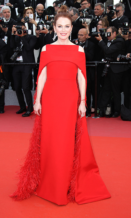 <p>A caped goddess, Julianne Moore stepped out in red feathered perfection for a screening of <em>Everybody Knows</em>.</p>