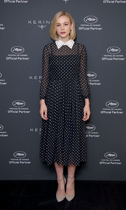<p>Carey Mulligan looked perfectly prim in a polka dot dress as she stopped for a quick shot at the Kering Women In Motion event.</p>