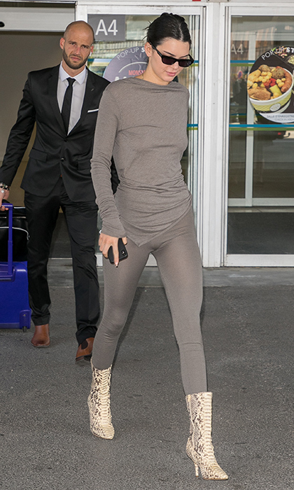 <p>The Kardashian-Jenner clan has officially started arriving! Kendall is the first of the family to touch down in Nice, sporting a sheer pair of grey leggings with a matching asymmetrical top and snakeskin boots.</p>