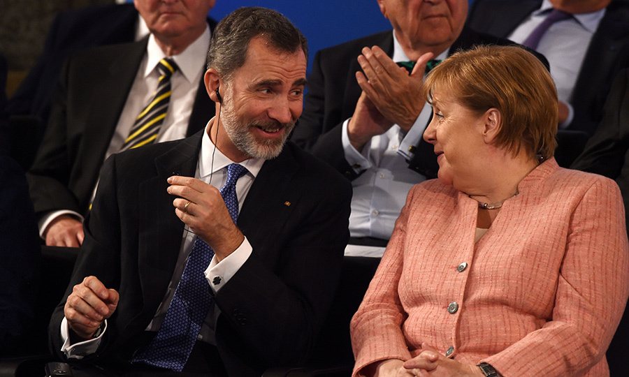<p>King Felipe VI chatted with German Chancellor Angela Merkel before the Charlemagne prize award ceremony on May 10. The royal was in Germany for the prestigious event.</p>