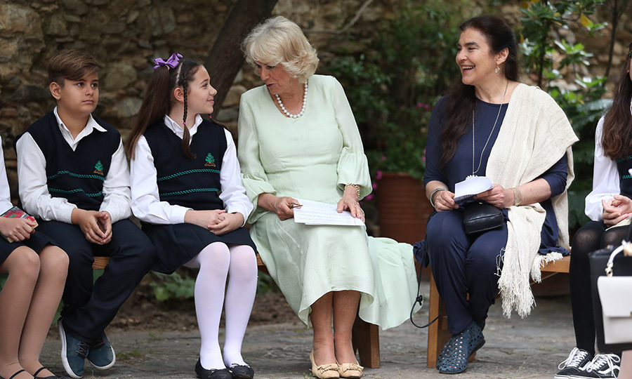 <p>Camilla, looking lovely as ever in mint green, read to a few students from IM Panagiotopoulos School. The Duchess of Cornwall was attending a UNESCO literacy event at the Kaisariani Monastery on May 10.</p>