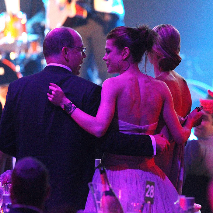 A photographer snapped this sweet, candid moment between Charlotte Casiraghi and her uncle, Prince Albert II of Monaco. The two were dancing at the amfAR Cinema Against AIDS Gala during the 64th Annual Cannes Film Festival at Hotel Du Cap in 2011.