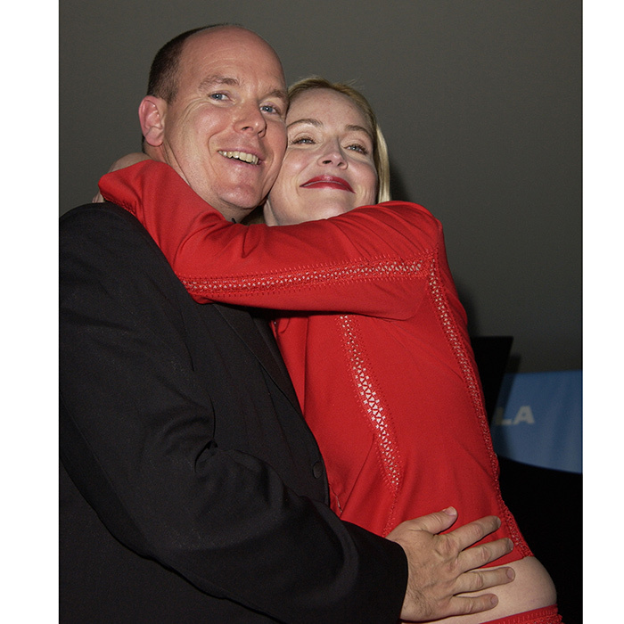 Hugs all around! Prince Albert II and Sharon Stone got up close and personal at amfAR's Cinema Against AIDS Gala in 2002.