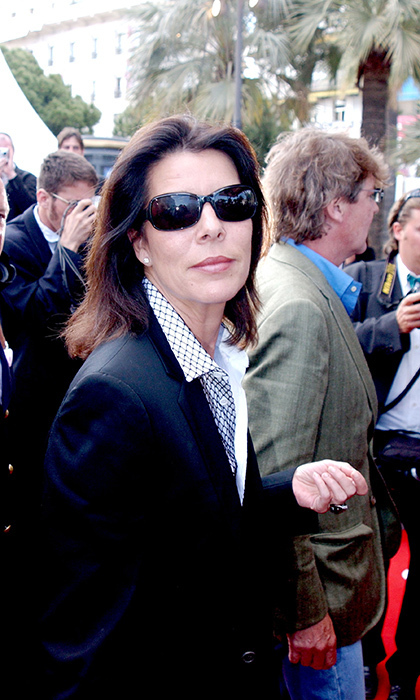 The one must-have accessory in Cannes is movie star shades! Princess Caroline of Monaco wore her dark sunglasses on the red carpet for the <em>Fahrenheit 911</em> premiere at Palais Des Festival in 2004.