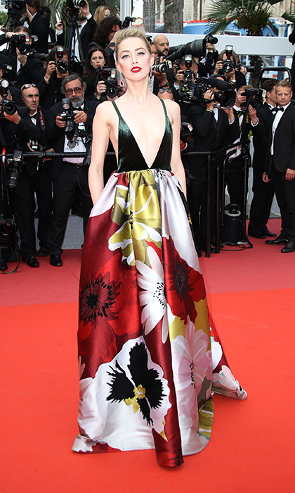 <p>Amber Heard was another stunner at the <em>Sorry Angel</em> premiere, rocking a gorgeous Valentino gown for the occasion.</p>