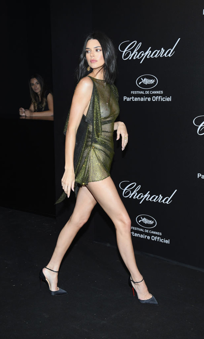 <p>Kendall Jenner knows how to make a fashion statement! The model and reality TV star walked to the Chopard Secret Night party at Chateau de la Croix des Gardes in a mesh, barely there mini dress.</p>