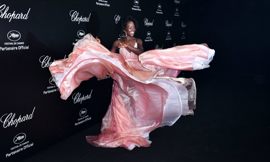 <p>Lupita Nyong'o was clearly having the time of her life with this gown! The Mexican-Kenyan actress flaunted a grand Prada dress while walking the party carpet on May 11..</p>