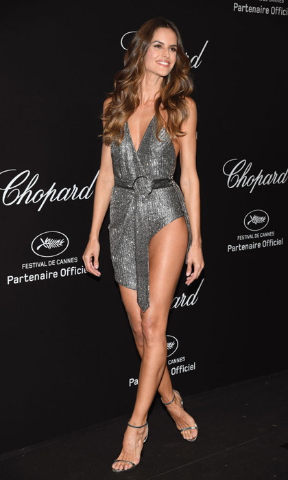 <p>Talk about a high slit! Izabel Goulart showed off her toned legs in a Julien Macdonald metallic mini dress on the Chopard Secret Night party carpet at Chateau de la Croix des Gardes..</p>