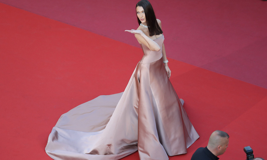 <p>Bella Hadid blew kisses to photographers while on the carpet for <em>Ash is the Purest White</em> premiere. The night before the May 11th carpet, the supermodel was spotted kissing someone else at a Cannes after-party, her ex The Weeknd..</p>