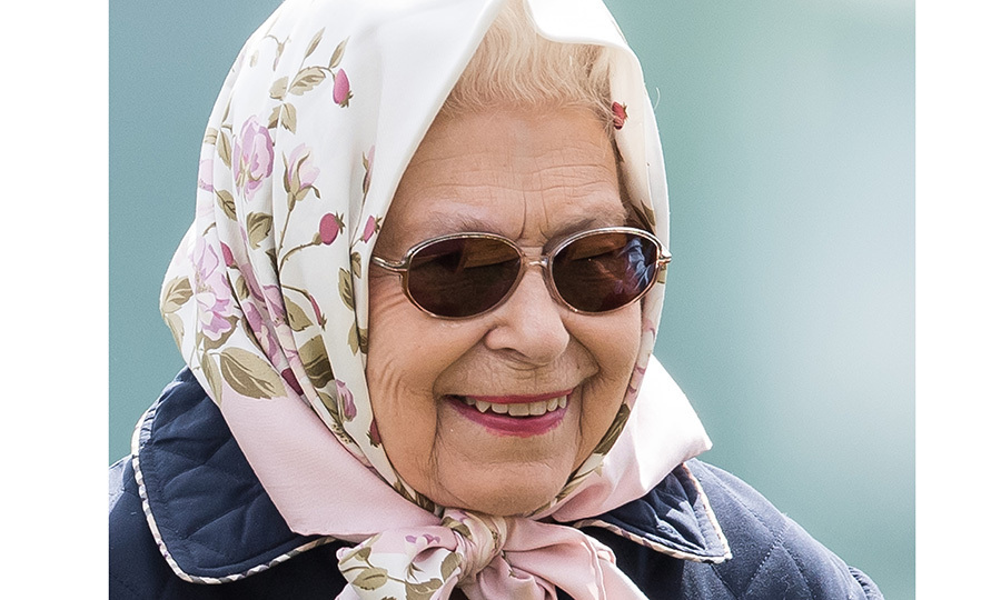 <p>Her Majesty wore one of her signature scarves for Day 3 of the Royal Windsor Horse Show in Windsor, the town where grandson Prince Harry will wed Meghan Markle on May 19. The annual horse show is held in the private grounds of Windsor Castle.</p>