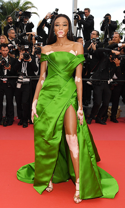 <p>Model Winnie Harlow's bright green gown made jaws drop at the premiere for <em>Blackkklansman</em> on May 14.</p>