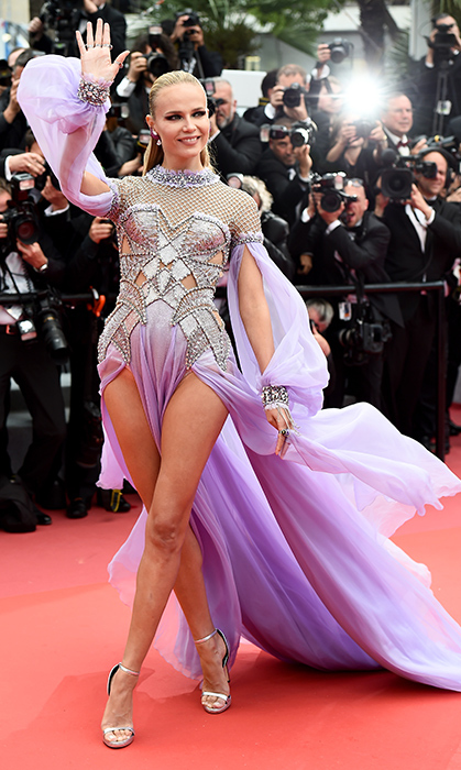 <p>Russian model Natasha Poly stole the show in this elaborate pale purple number – with daringly high slits!</p>