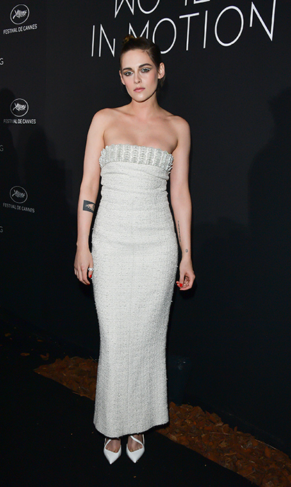 Jury member Kristen Stewart was back in Chanel, this time a strapless tweed number, at the Women in Motion dinner.